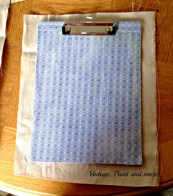 Stenciled Clip Boards - image of clip board lying on fabric
