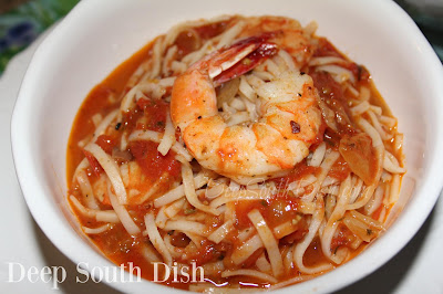 Oven roasted shrimp served in a fiery, tomato based sauce with pasta.