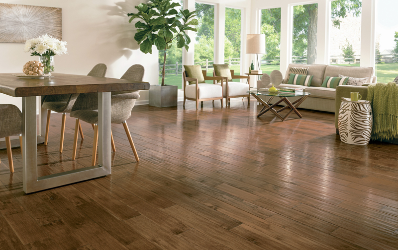 Durability and function are key considerations when choosing flooring for an open-concept floor plan space