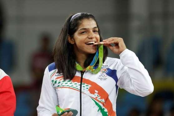Wrestler Sakshi Malik wins India's First Medal