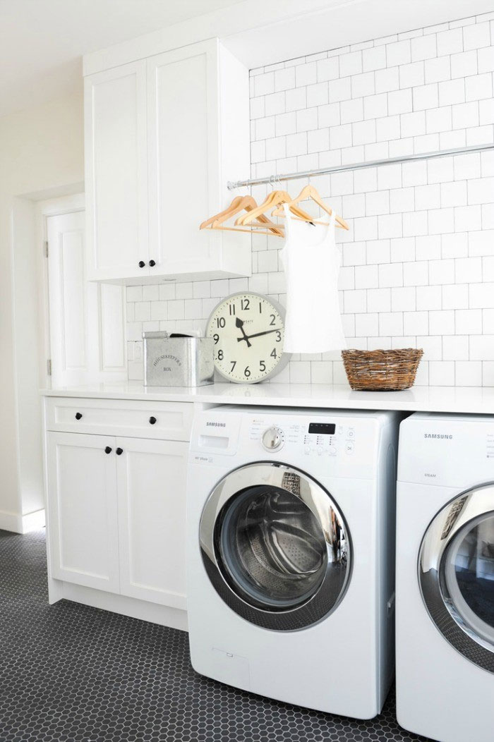 You could have a clean and stylish laundry room like this!  Check out eight simple tips for making house cleaning fast and easy.  (Image via Scout and Nimble)