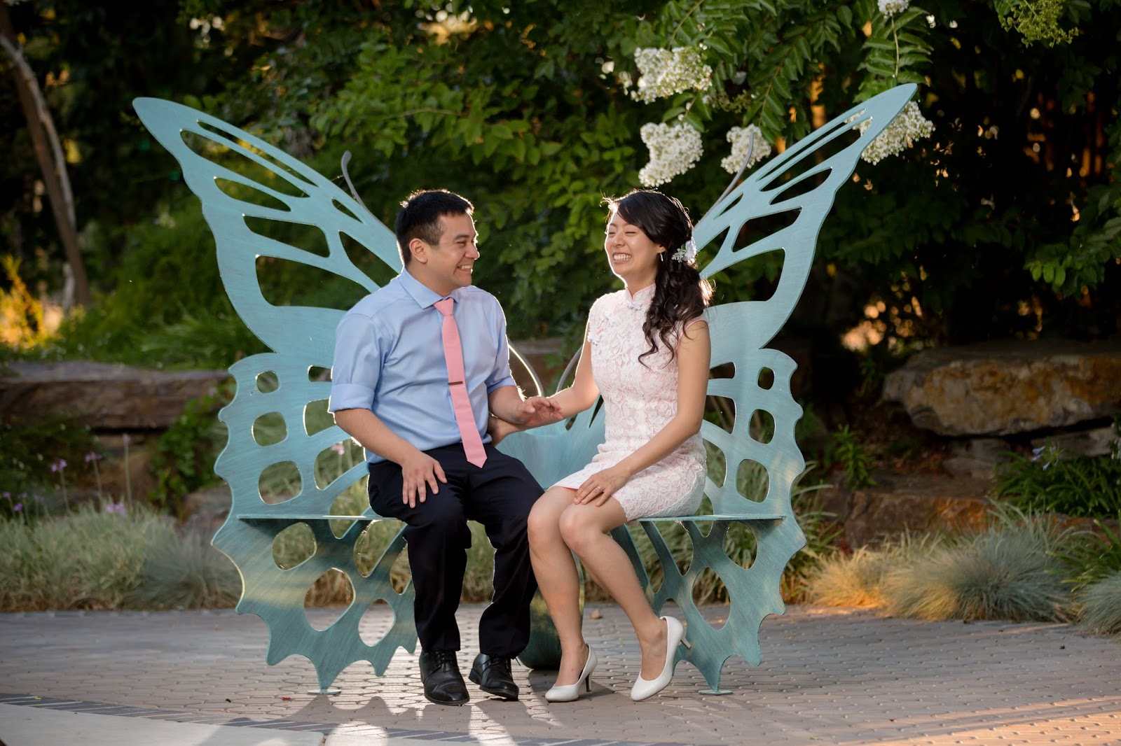 bride and groom in butterfly chair