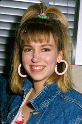 Debbie Gibson wearing hooped earrings in the 80s