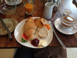 Vegan breakfast at Bistro Bardot: croissant, melon, vegan 'meats', coffee, orange juice.