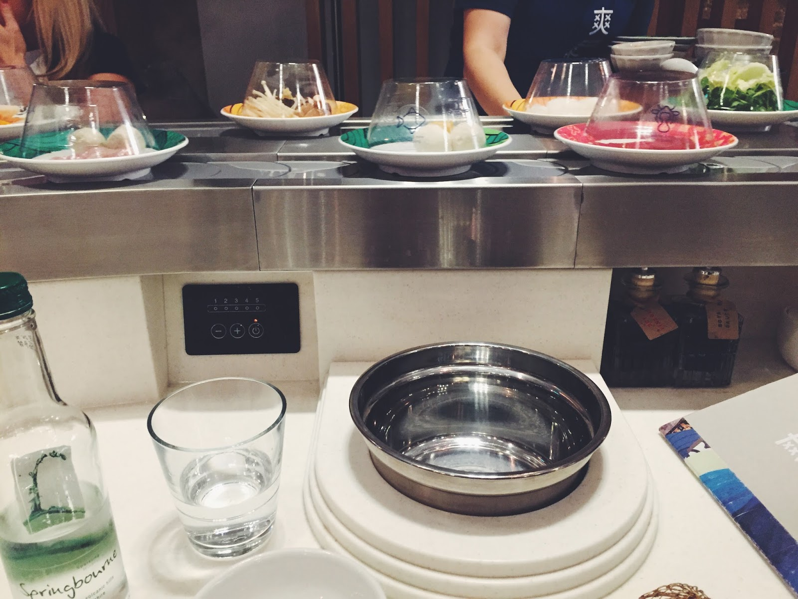 Shuang Shuang: Conveyor belts and boiling broth