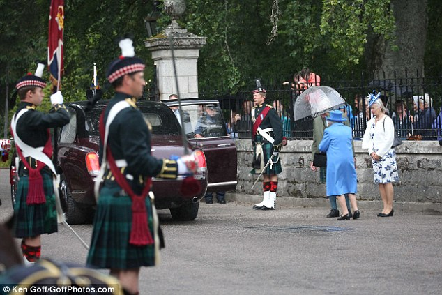 The Queen looks radiant in blue arrives at Balmoral Castle at the start of her annual summer break in Scotland