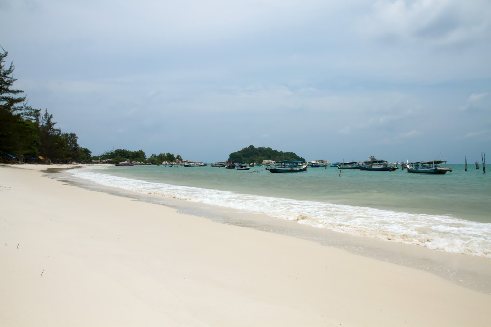 on a white sandy beach in belitung