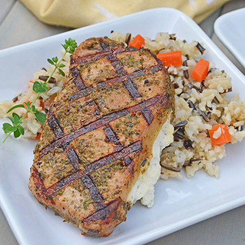 Roasted Garlic and Herb Pork Chops Stuffed with Boursin Cheese