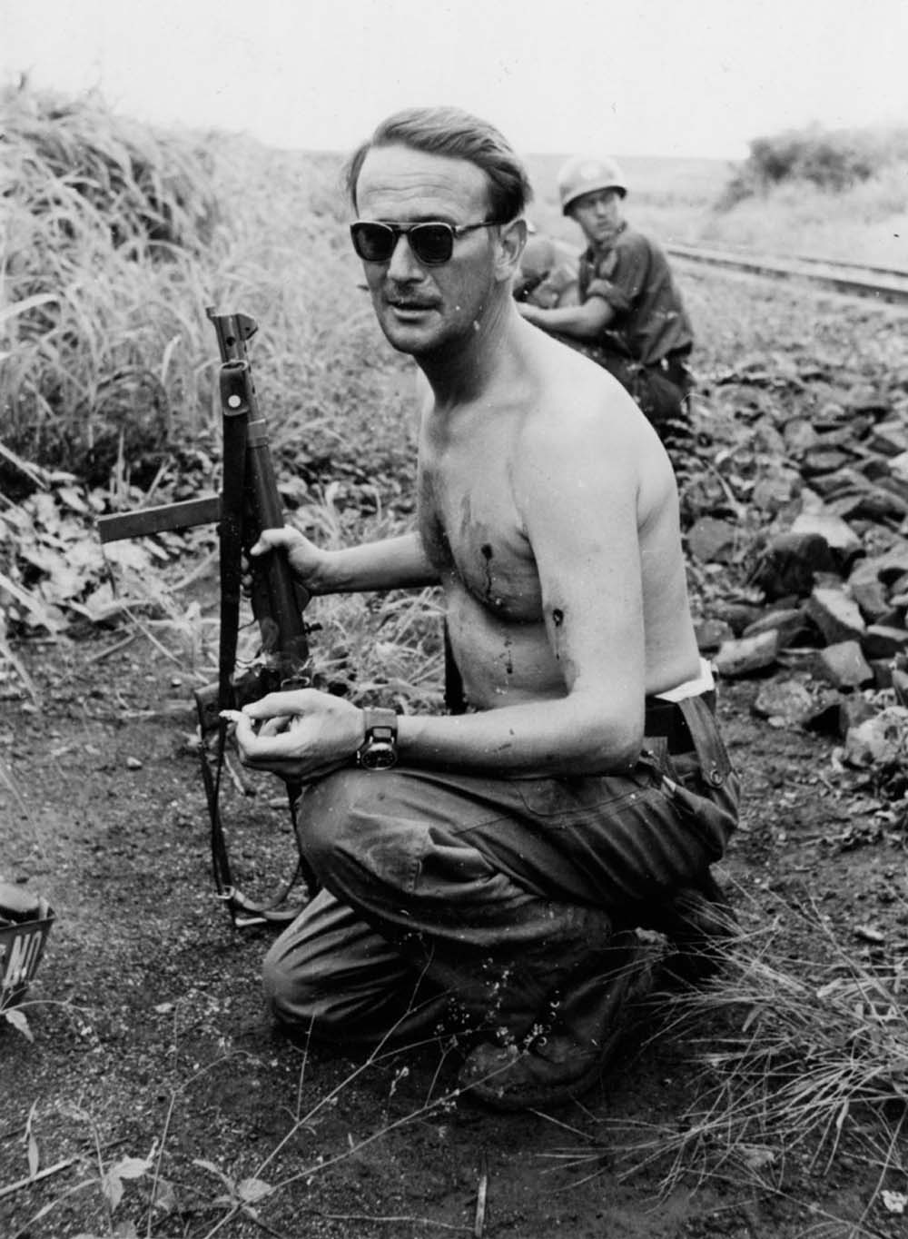 Swedish Major Erik Bonde smokes a cigarette after being ambushed and shot twice. Congo, Jan 15th 1961.