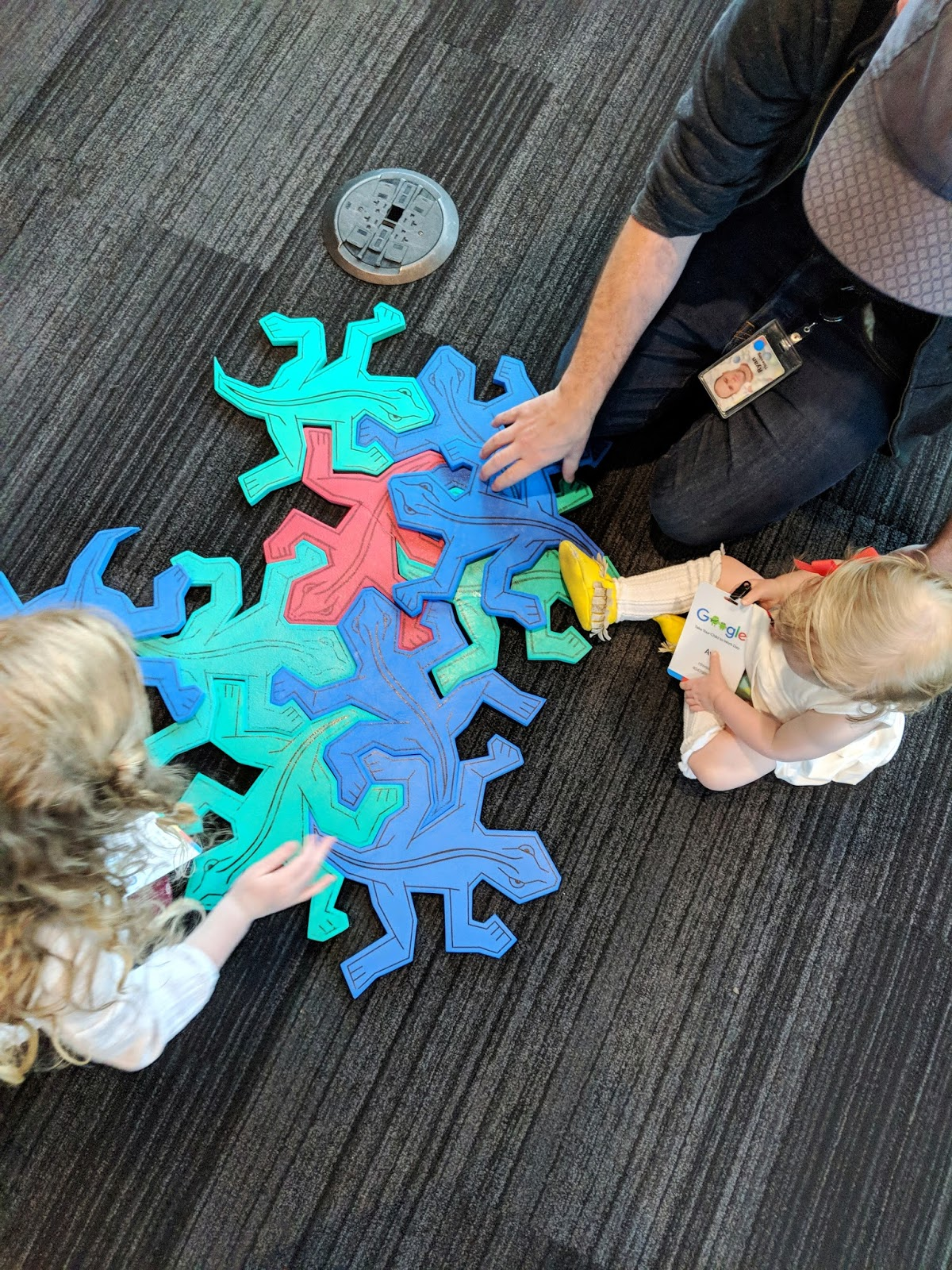 dad helping children put lizard puzzle together playtime daddy father learning growing family