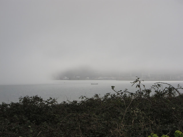 Isle of Portland (Dorset) disappearing into mist.