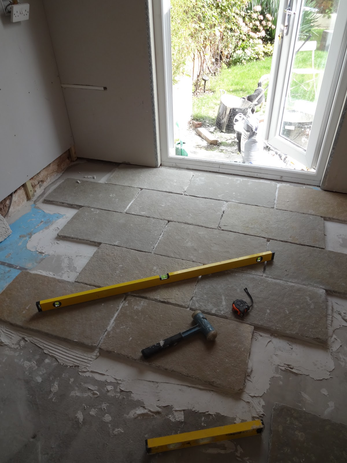 Kezzabeth uk home renovation interiors and diy blog laying limestone tiles diy diy limestone floor dailygadgetfo Images