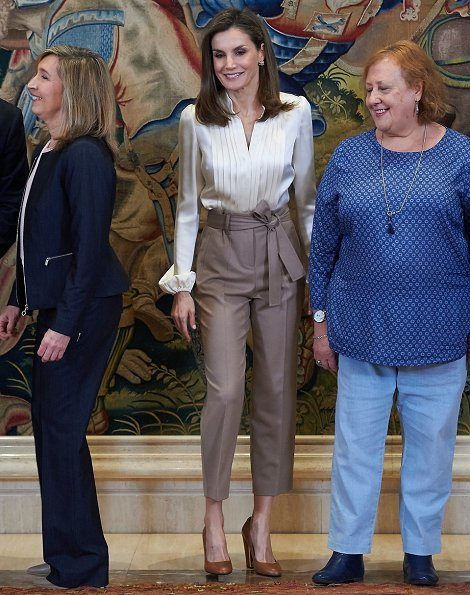 Queen Letizia wore Massimo Dutti darts and tied details Trousers and Uterque Shoes, and Hugo Boss blouse