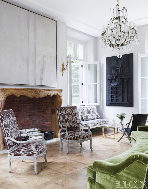 Emma Jane Pilkington home living room with crystal chandelier green sofa and antique chairs