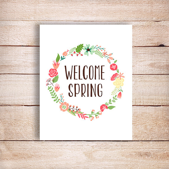 Welcome Spring postcard on wooden table