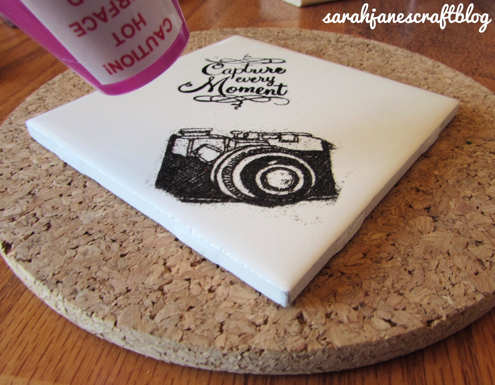Sarah janes craft blog embossed ceramic tiles ink which is about the consistency of vaseline and works great for embossing powder it sticks like a dream and carefully stamped it onto the tile dailygadgetfo Image collections