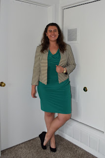 an outfit with a green sheath dress, a black and white striped blazer, and black wedges