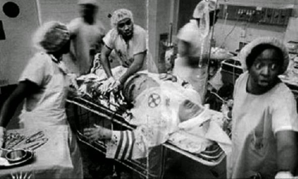 Ultimate Collection Of Rare Historical Photos. A Big Piece Of History (200 Pictures) - Ku Klux Klan member being operated
