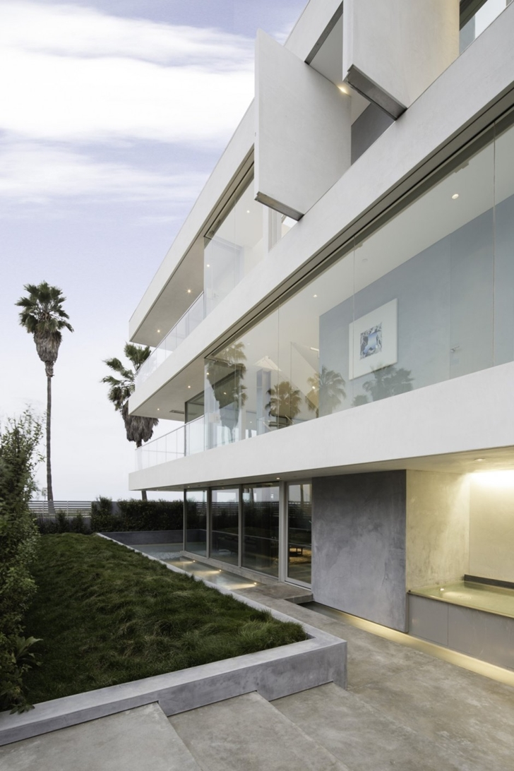 Glass and concrete facade on Modern mansion on the beach by Dan Brunn