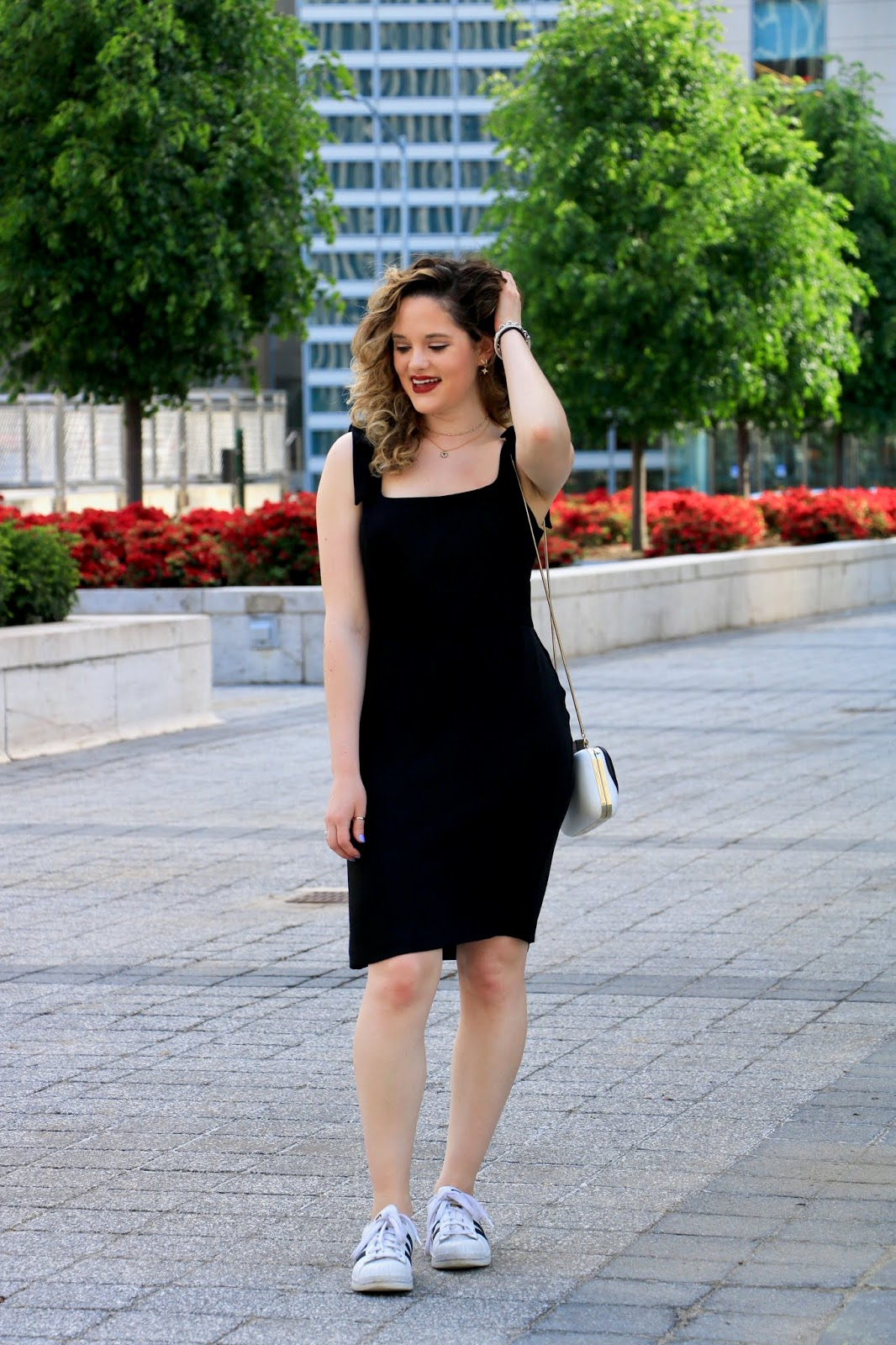 Nyc fashion blogger Kathleen Harper wearing a cute black dress for work.