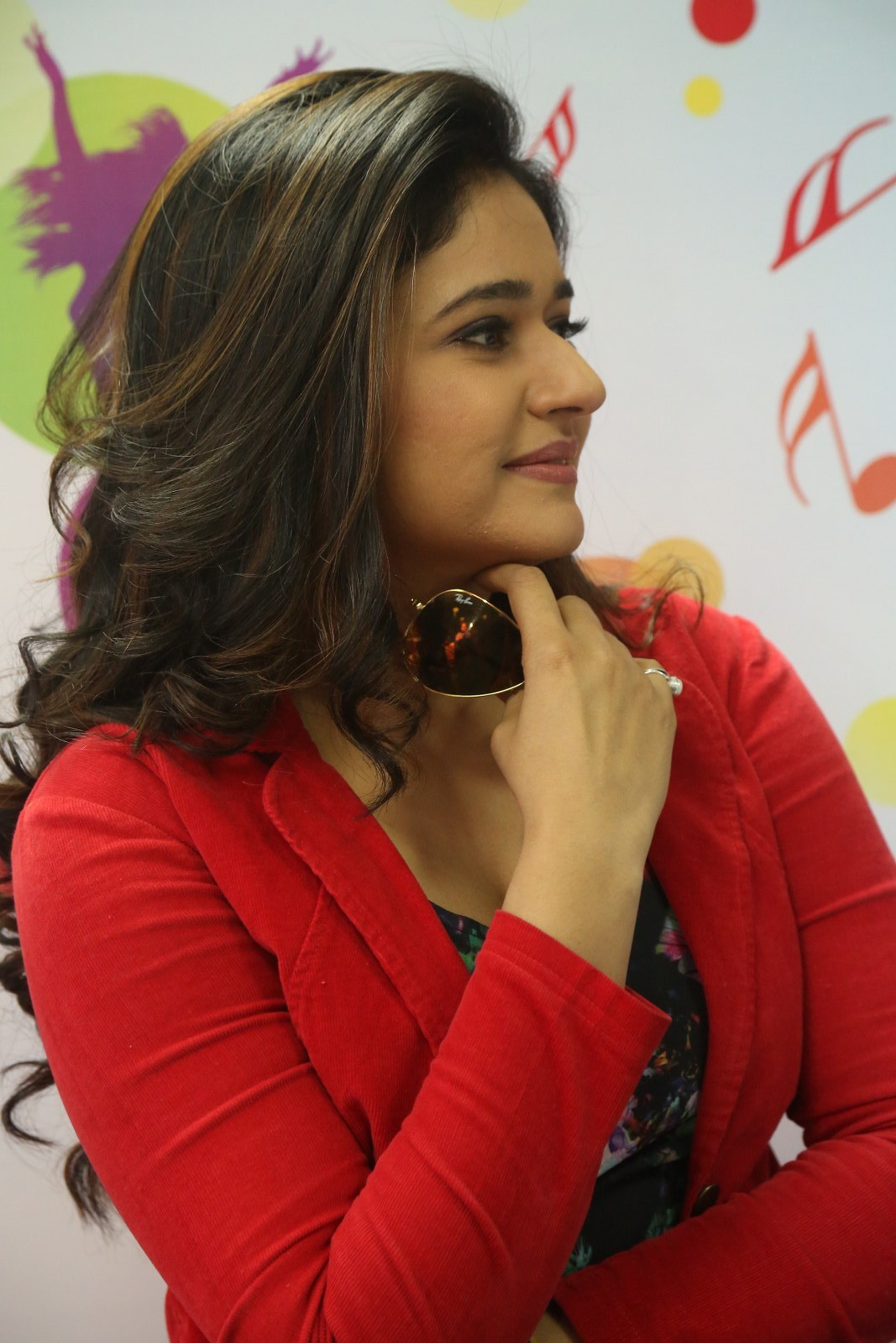 Poonam Bajwa Stills At Radio City In Red Dress