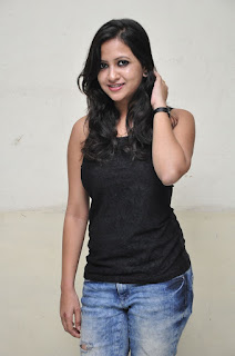 Pavithra New South Indian Beauty in a black Tank top and Ripped Jeans