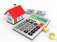 Toy house and calculator representing home refinancing