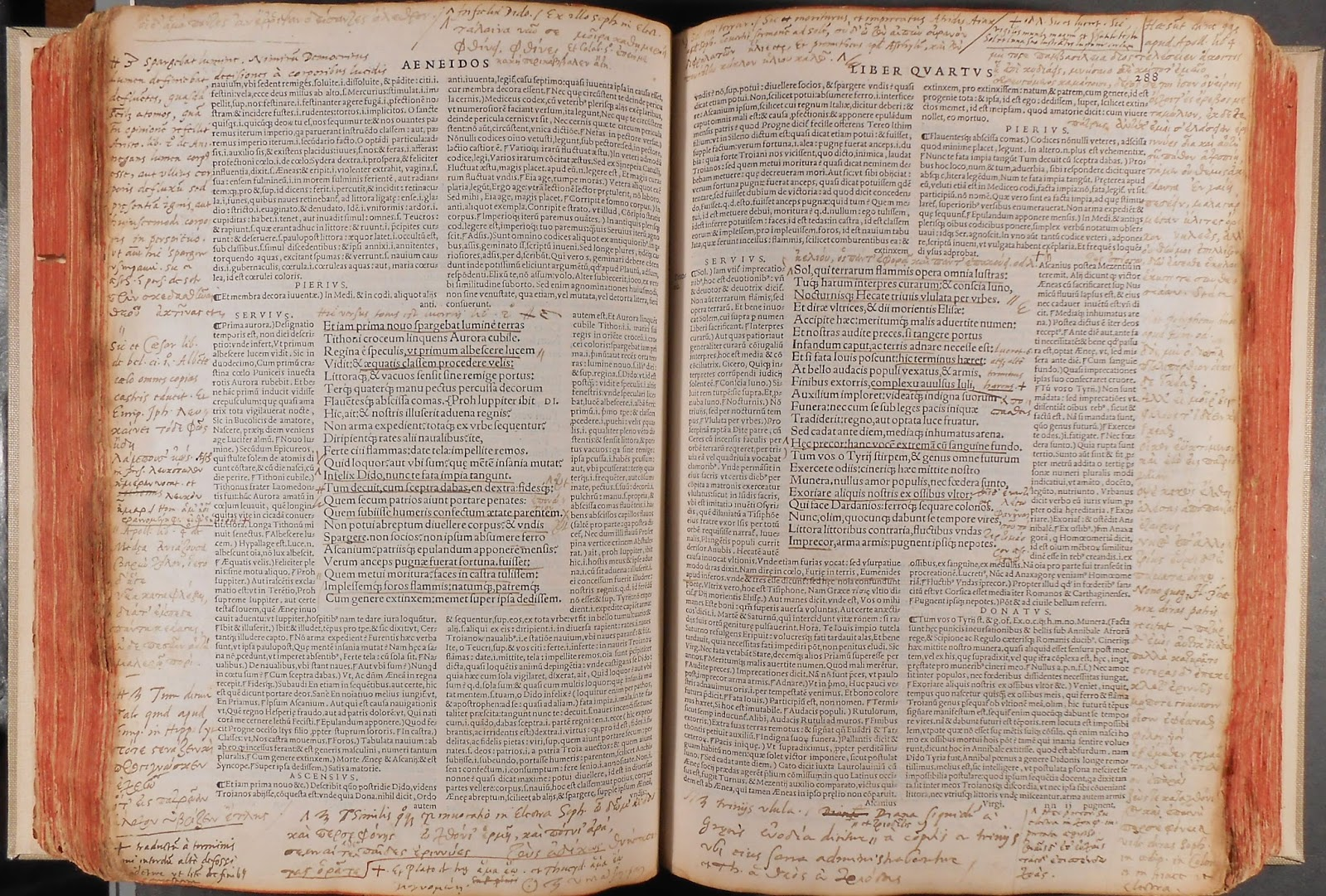 A printed book of Virgil with extensive notes in the margins.