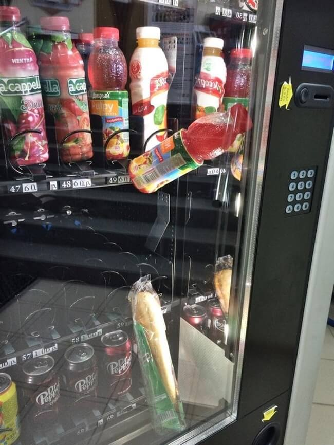 26 Times Life Went Unbelievably Wrong - His sandwich got stuck in the vending machine, so he bought a drink to push the sandwich down. Here is the epic result.