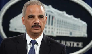 Eric Holder calls for protests if Trump fires Mueller