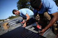 Installing solar on a rooftop, like this system on a home in San Mateo, Calif., is getting faster and easier as cities comply with a California law requiring a speedier permitting process. (Credit: Getty Images) Click to Enlarge.