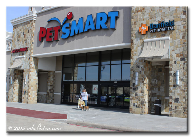PetSmart store with woman and Basset in front