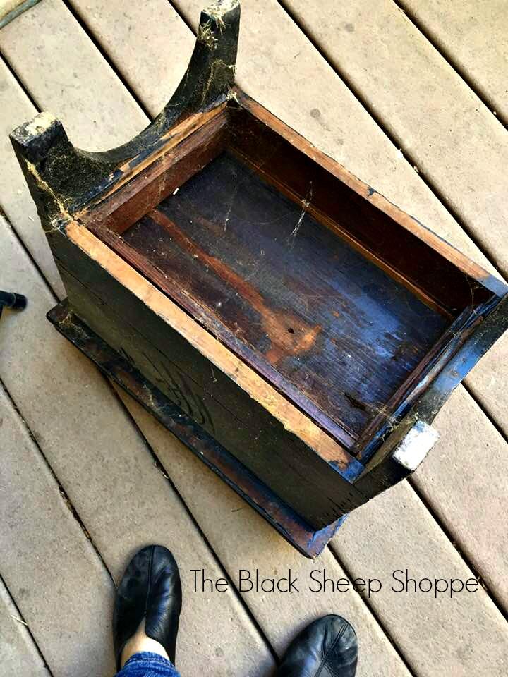 Bottom of shoe shine box.