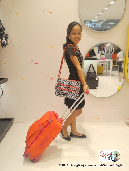 Kipling red-orange luggage