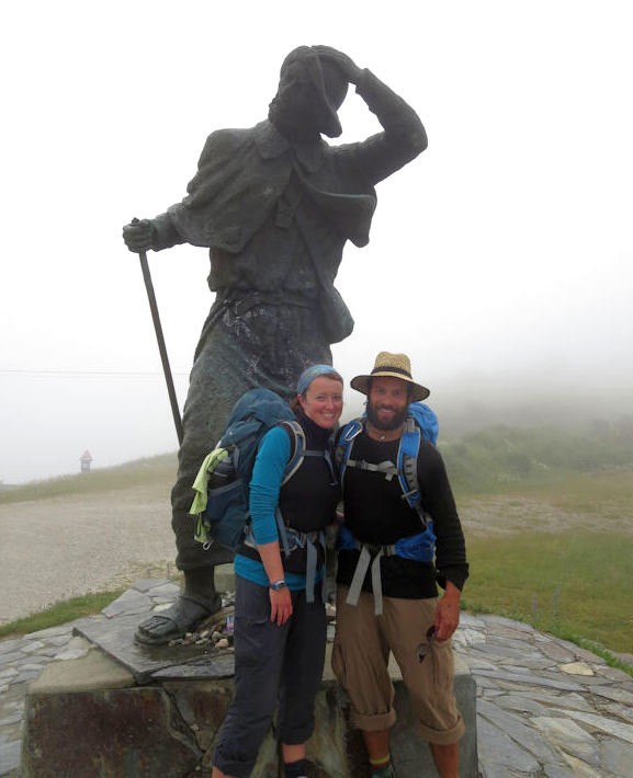 Jusino with husband Eric pause with the lone pilgrim who stands atop Alto de San Roque in his final stretch to Santiago.