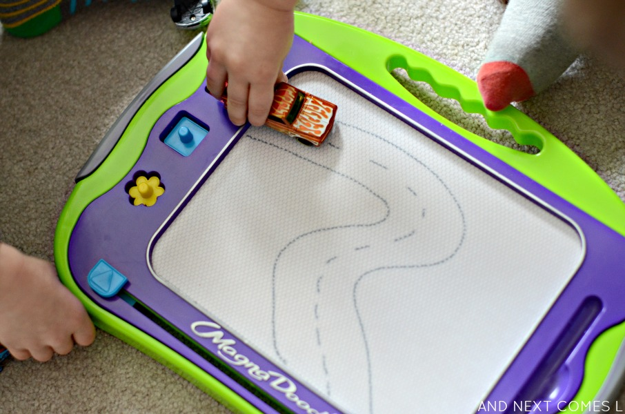 Open-ended play for kids with cars and a Magna-Doodle from And Next Comes L