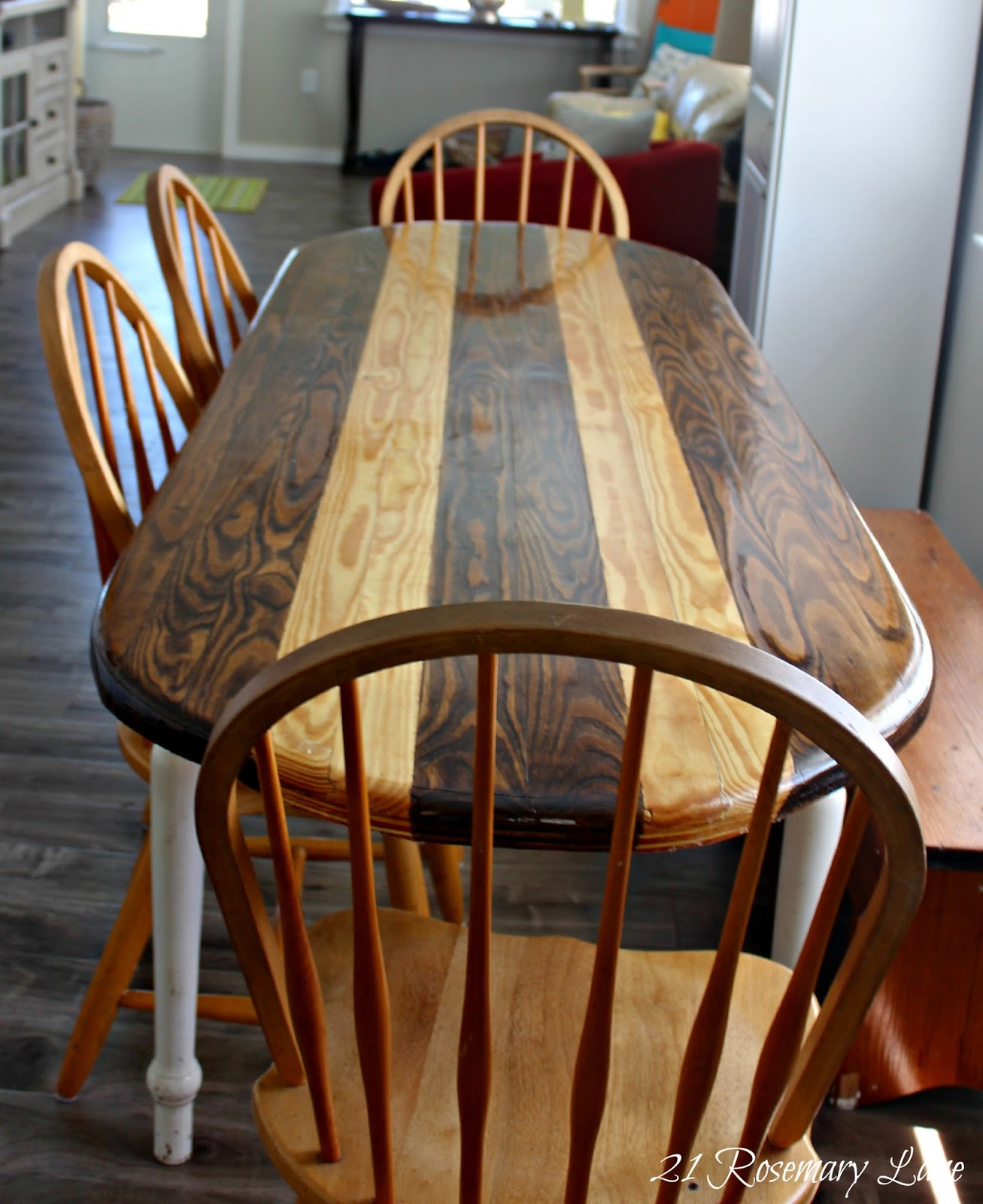 thrifty beach home remodel after beachy kitchen table In keeping with the beachy theme of their home Ken decided to create a surf board inspired table top for the new dining table This beautiful top was made