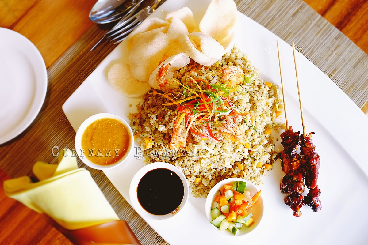 Botany Signature Fried Rice (Nasi Goreng Kencur) served with chicken satay, pickles and crackers