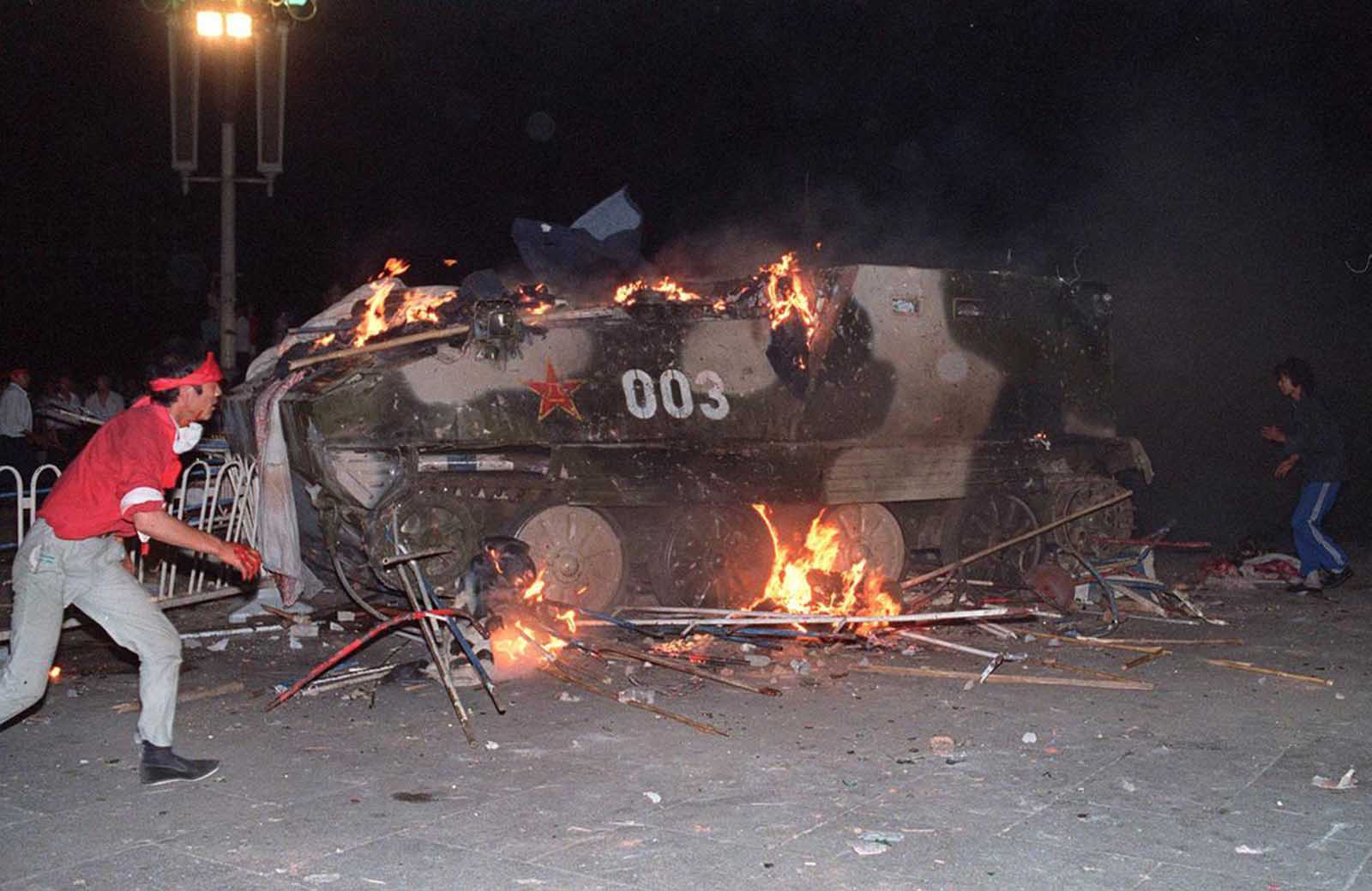 An armored personnel carrier, in flames after students set it on fire near Tiananmen Square, on June 4, 1989.