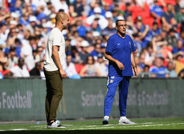 Pep Guardiola and Maurizio Sarri instructs their players during Manchester City vs Chelsea community shield match