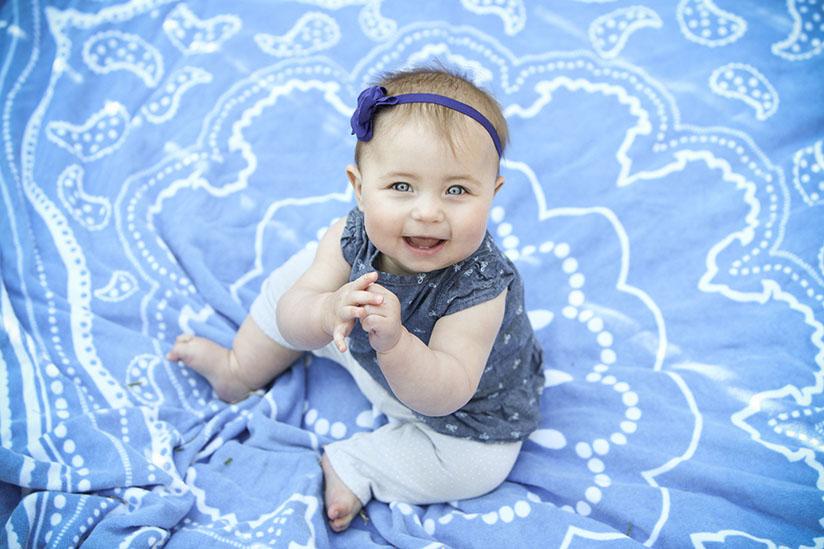 baby girl on blue towel