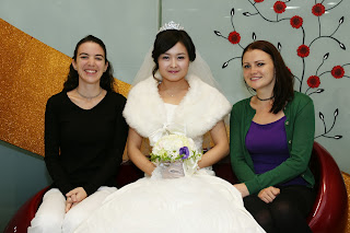 Korean bride before the wedding ceremony having photos - work friends