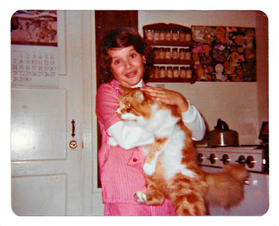 Milan Mejia-Prieto and Amber the Cat in Broadmoor, California in the late 1970s