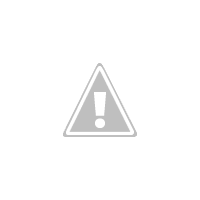 Crowd In Front Of MC Oluomo's House, To Welcome Him Back From US Were He Received Treatment.