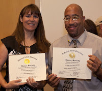 two honorees holding up their certificate