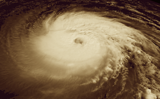 Screengrab of NOAA satellite image of hurricane, with sepia tone added