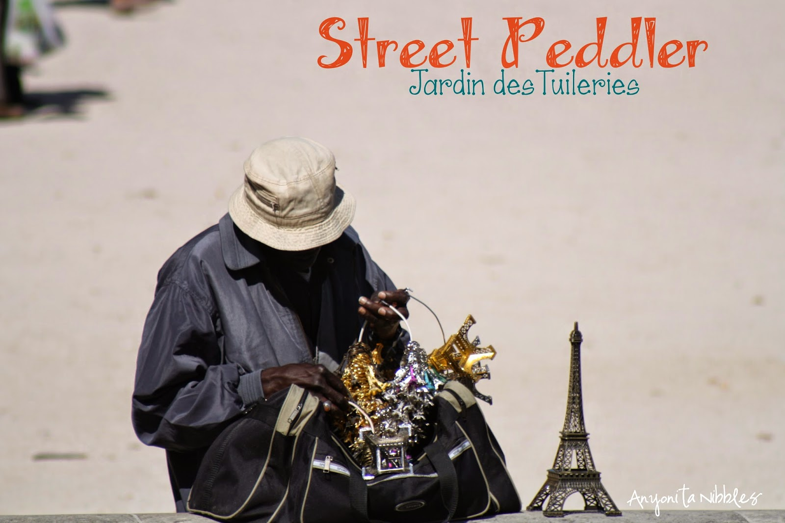 A street peddlar in Paris, France by Anyonita Nibbles