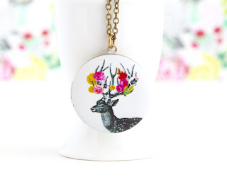 http://www.jacarandadesigns.com/collections/lockets/products/woodland-locket-deer-christmas-locket-reindeer-locket-photo-locket-painted-locket-necklace-gift-for-young-woman