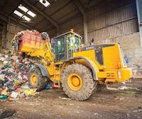 máy-xúc-lật-xử-lý-rác-thải