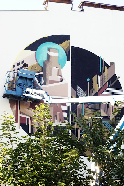 street artist jacyndol and seikon working on a new mural